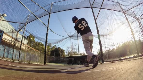 Thumbnail for A baseball player practicing at the batting cages.
