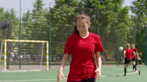 Thumbnail for Young Cheerful Soccer Girl Dribbling Ball and Posing for Camera