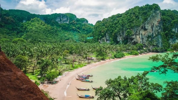 Thumbnail for Hat Tom Sai Beach with Long Tail Boats on the Beach. Railay Travel Destination Near Ao Nang, Krabi