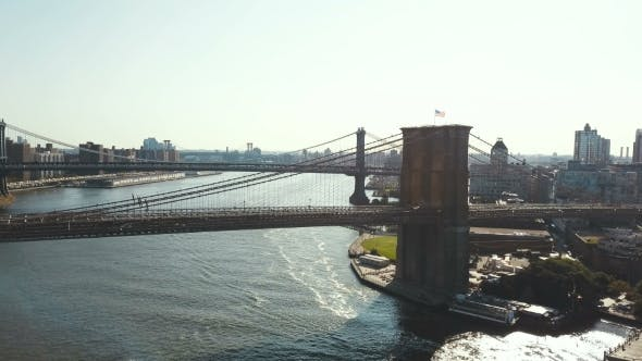 Thumbnail for New York, America. Drone Flying Over the Brooklyn Bridge To Manhattan Bridge