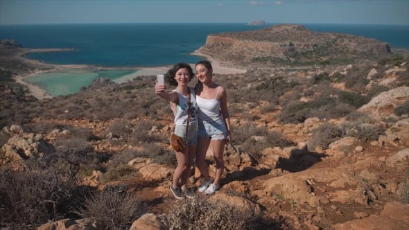 Thumbnail for Two Sisters Making a Selfie in Background of Sea