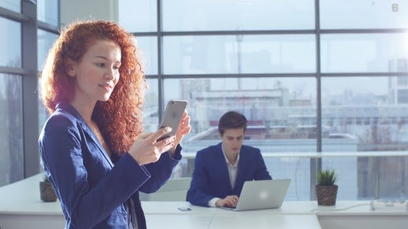 Thumbnail for Attractive Woman Using Smart Phone in the Office