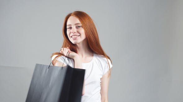 Thumbnail for Shopping Woman Happy Smiling Holding Shopping Bags Isolated on White Background.