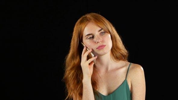 Thumbnail for Girl Talking on the Phone. Black Background