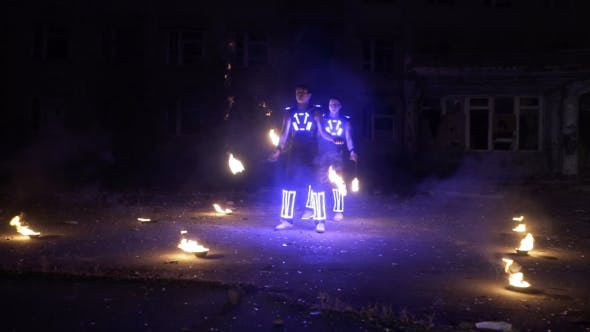 Thumbnail for LED Show Performance in Glowing Costume at Night