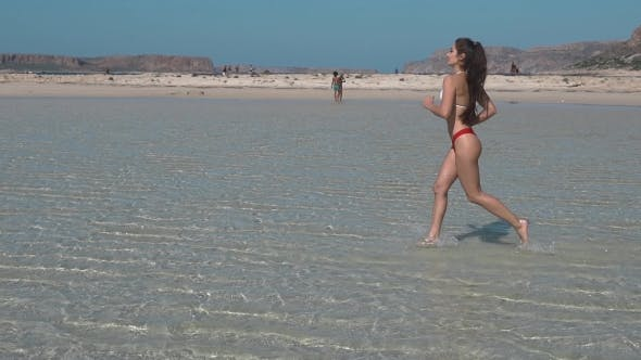 Thumbnail for Beautiful Young Girl Running Along the Beach