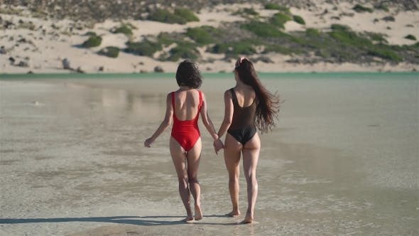 Thumbnail for Two Young Girls Walking Along the Beach