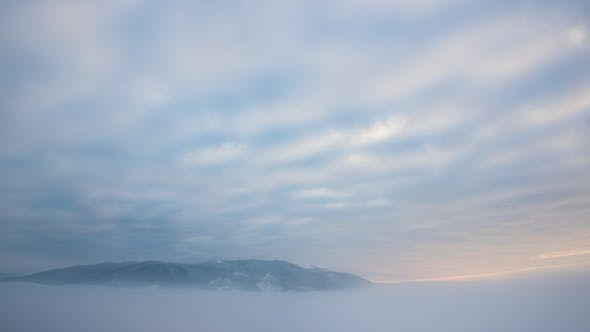Thumbnail for View in Foggy Sunset Winter Mountain