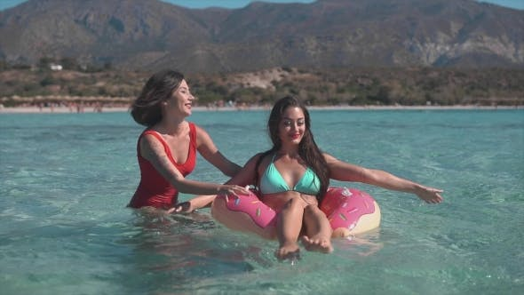 Thumbnail for Two Happy Ladies on Inflatable Ring