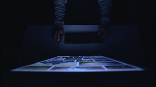 Designer Skims His Sketches in a Dark Room
