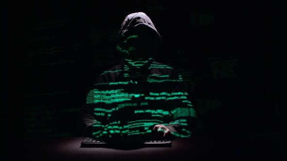 Thumbnail for Guy Writes Patches for Hacking Web Sites. Black Background. Silhouette