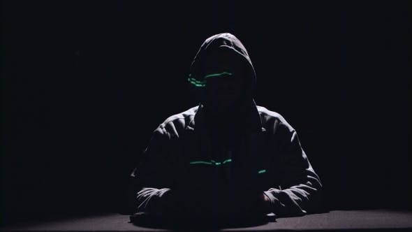 Thumbnail for Spy Is Typing Virus Patches on the Keyboard for Hacking. Black Background. Silhouette