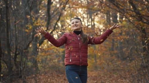 Woman Tosses Leaves