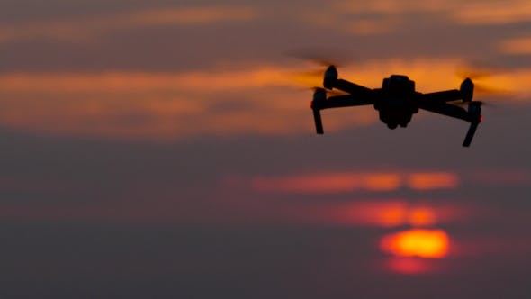 Thumbnail for Drone Revolves Around Its Axis Against the Background of the Sunset