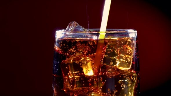 Thumbnail for Cola and Drink Tube with Ice and Bubbles in Glass.
