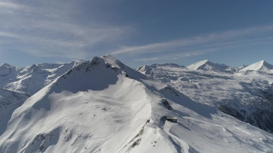 Thumbnail for Aerial View of Snowy Mountains and Ski Slopes
