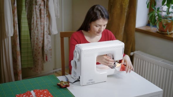 Thumbnail for Fashion Designer Is Sewing in Her Home Workshop in Day, Making Stitch By Sewing Machine