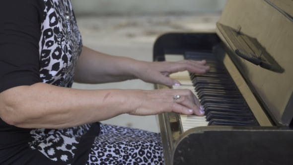 Thumbnail for Old Woman Playing the Piano