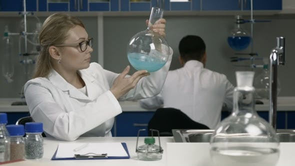 Thumbnail for Female Researcher Working in Chemistry Lab