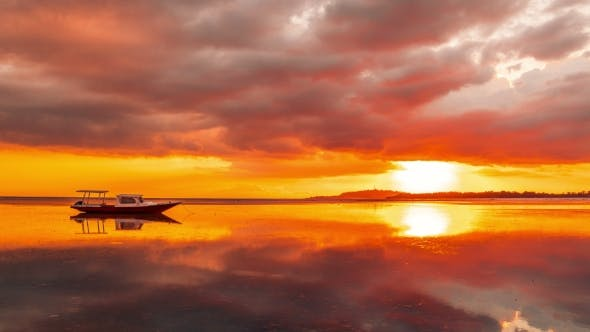 Cover Image for Orange Sunset on the Background Boat on the Beach of Gili Meno, Indonesia