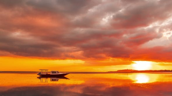 Thumbnail for Boat on the Sea at the Orange Sunset of Gili Meno, Indonesia