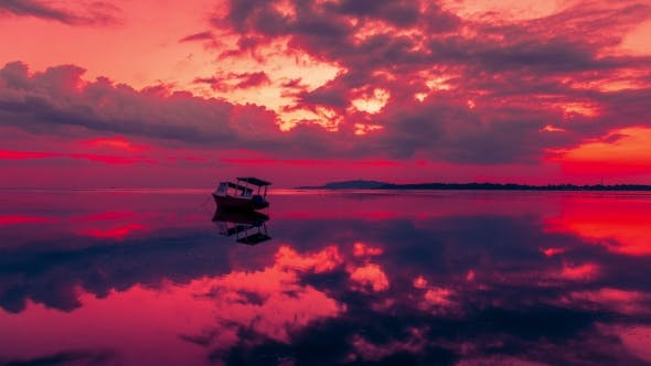 Cover Image for Fishing Boat on the Gili Air Sea with a Dramatic Red Sunset, Indonesia