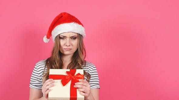 Thumbnail for Attractive Girl Hold Gift Box in Hands and Showing Different Emotions