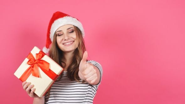 Thumbnail for Portrait of Beautiful Smiling Girl Holding Christmas Gift Box in Hands