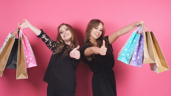 Thumbnail for Two Beautiful Smiling Girl with a Lot of Shopping Bags