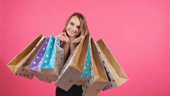 Cover Image for Beautiful Smiling Girl with a Lot of Shopping Bags.