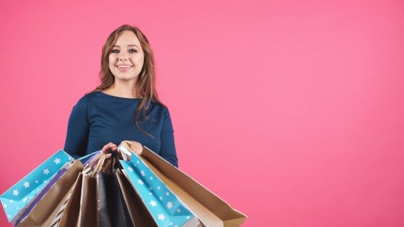 Thumbnail for Beautiful Smiling Girl with a Lot of Shopping Bags