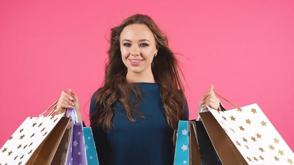 Thumbnail for Portrait of Happy Smiling Woman Hold Shopping Bag