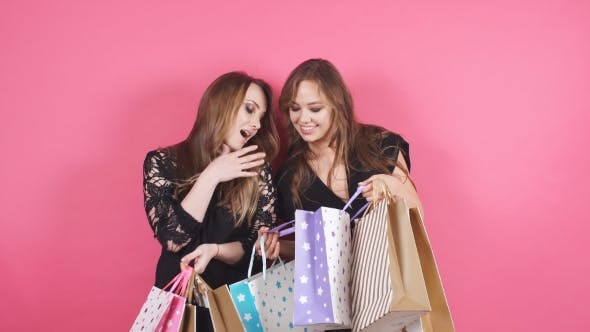 Thumbnail for Portrait of Two Happy Smiling Woman Hold Shopping Bag. Female Model Isolated Studio Background.