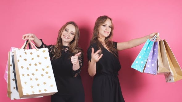 Thumbnail for Two Beautiful Smiling Girl with a Lot of Shopping Bags.