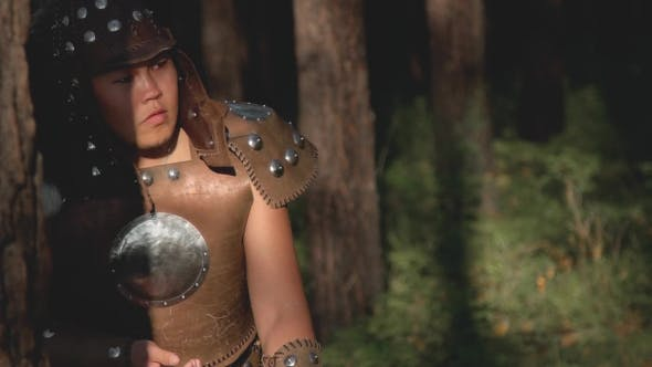Thumbnail for Male Archer Shoots Bow Standing in Forest on Summer Afternoon.