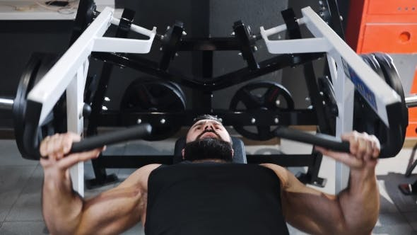 Thumbnail for Strong Man Is Pumping Muscles at the Gym, Strength Exercises on Simulators, Athlete at Fitness Club