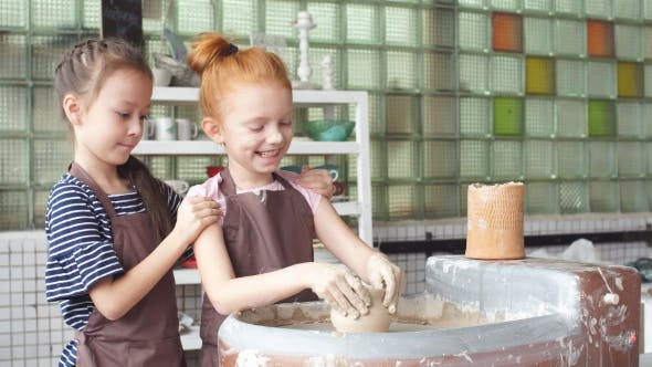 Thumbnail for Two Little Girl Having Fun Playing with Clay on a Pottery Wheel.
