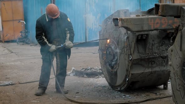 Thumbnail for Factory Worker Using Special Welding While Working with Metal Construction