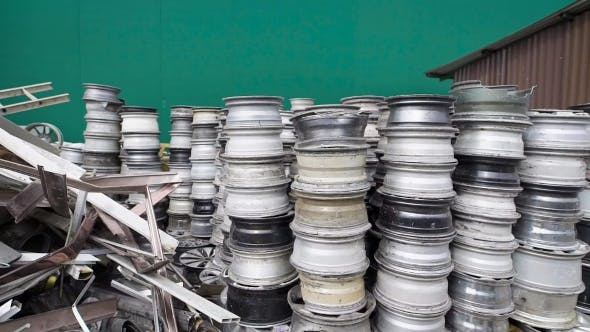 Thumbnail for Stacked Cars Rims and Discs on Recycling Storage of Manufactory