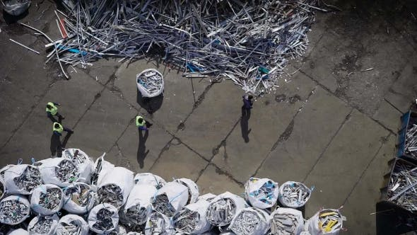 Thumbnail for View of Workers of Recycling Manufactory Sorting Garbage Into Bags