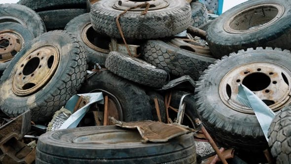 Thumbnail for View of Plenty of Weathered Car Tires Ready for Recycling