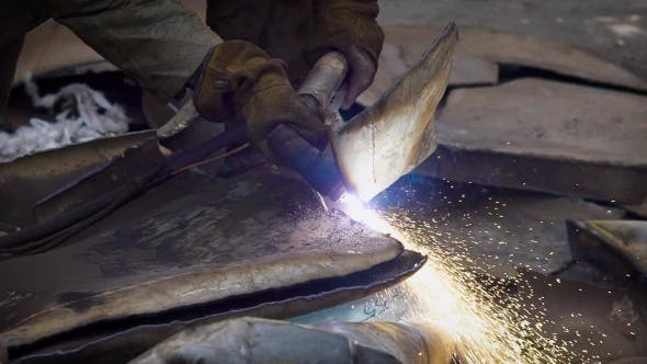 Thumbnail for Man Using Welding While Recycling Trash in Workshop of Manufacture