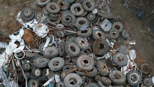 Top View of Rusty Tires Lying in Heap on Disposal Dump