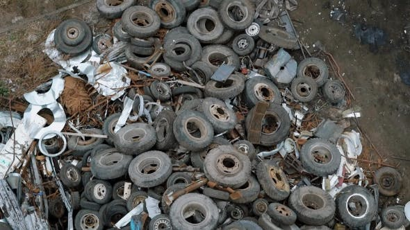 Thumbnail for Top View of Rusty Tires Lying in Heap on Disposal Dump