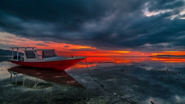 Cover Image for Dramatic Red Sunset with Silhouette of Fisher Boat Near Gili Air Island, Lombok. Indonesia