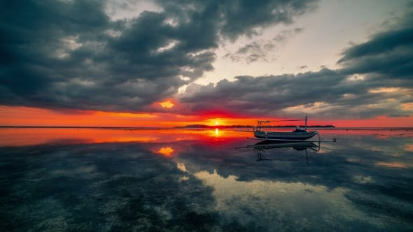 Thumbnail for Сlouds and Sunset Reflected in the Water on the Island of Gili, Indonesia