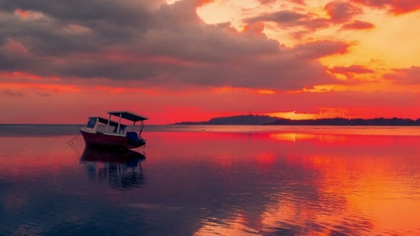 Cover Image for Fishing Boat on the Gili Sea with a Gorgeous Red Sunset As a Backgound, Indonesia