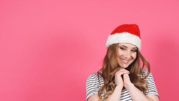 Thumbnail for Pretty Cheerful Girl at Christmas Hat Smiling and Looking at Camera
