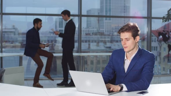 Thumbnail for Business, People, Paperwork and Technology Concept - Busy Businessman with Laptop Computer