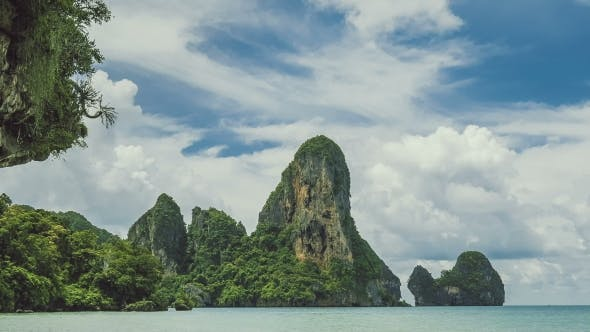 Thumbnail for White Clouds Moving Above of the Limestone Cliff Rocks at Railay Beach Krabi Thailand
